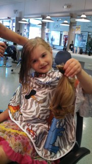 Donating her hair to Locks of Love. She was very excited!