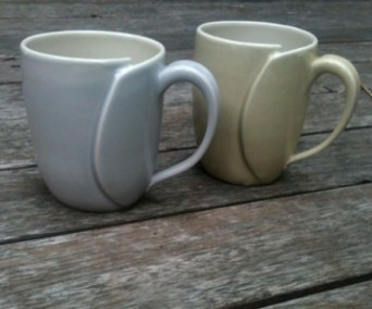 The traditional handles - pictured in the lavender grey and sandy glazes