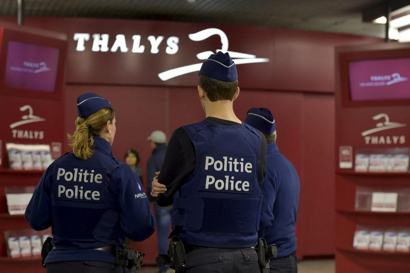 Belgian police officers patrol at Gare du Midi/Zuidstation railway station in Brussels