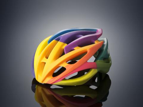 Bike helmet 3D printed on the Objet500 Connex3 Color Multi-material 3D Printer in one print job usin ...