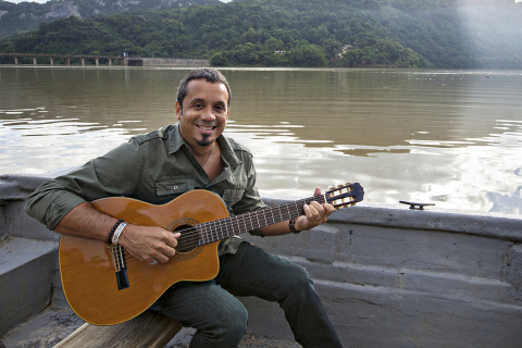 "Millo Torres during the filming of Popular's music special ""Qué lindo es Puerto Rico"" in the Lago Do ..."
