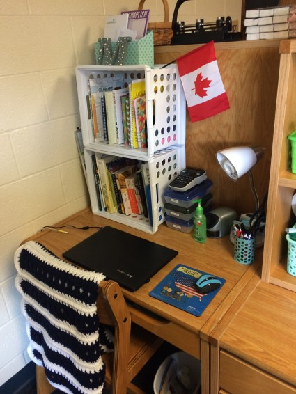 ...And my Canadian flag. That is also important. Also, the afghan on my desk chair was a gift from someone in my church - she made is specifically in my school colors! I love it so much.