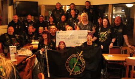 Group photo of the Dragon Slayers MCC presenting a cheque to Branch Secreatry Marian Dent