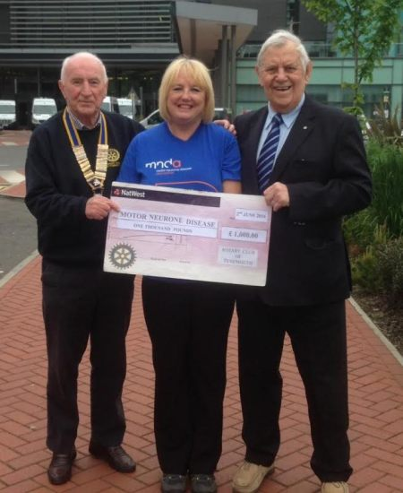 Rotary President Archie presenting the cheque to Marion, supported by Commander Bryan Rayner
