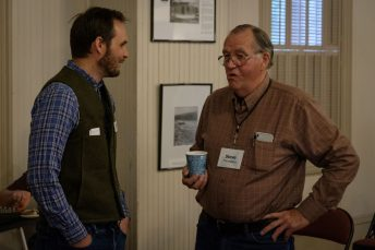 Andrew talking with a volunteer