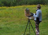 Artist, Megan Schmidt painting