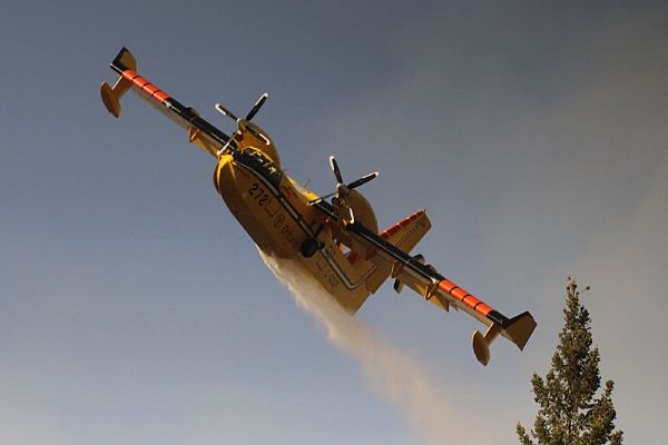 A Ministry of Natural Resources water bomber attacks a brush fire in the Stanley area on Monday evening.