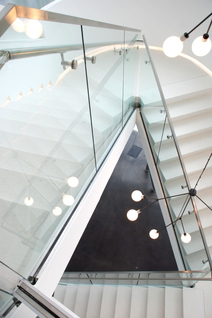 Office stairwell glass railing
