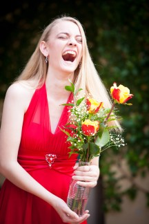Girl laughs and accepts flowers