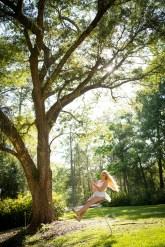 High school senior swings from an oak tree