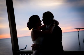 Silhouette of a bride and groom sharing an embrace