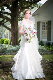 A picture-perfect bride in front of her family home