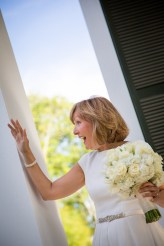 A joyous bride waiting for the ceremony to begin