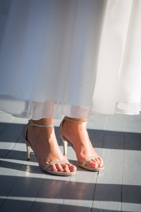 A simple tea-length gown and sparkling strappy high heals