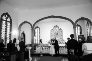 Bride and groom kiss at St. Paul's Chapel