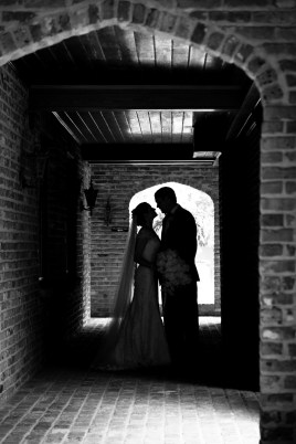 Silhouette of a bride and groom under an arch