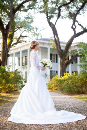 A bridal portrait of a beautiful woman in a long, elegant wedding dress at the Bragg-Mitchell Mansion in Mobile, Alabama