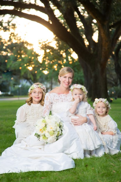 A bride and her three flower girls in heirloom lace dresses