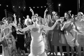 Bride is the center of attention at her wedding reception
