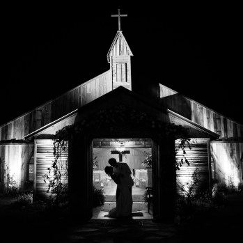 A kiss in the doorway of the Blackwater Farms Chapel