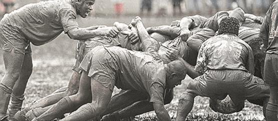 rugby-scrum-in-the-mud-680x309-555x242
