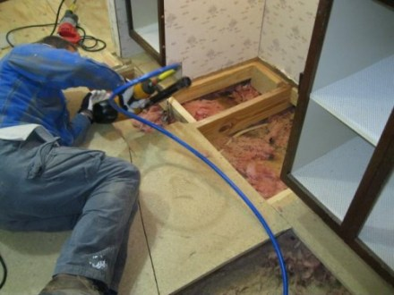 How to Replace Flooring in a Mobile Home   Mobile Home Living removing old subflooring and laying new in a mobile home
