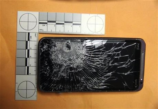 131029-htc  HTC Phone Stops Bullet, Saves Clerk's Life