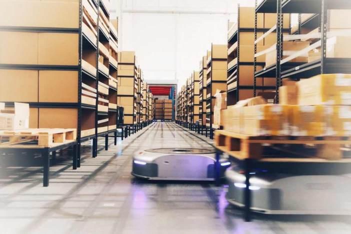 Geek Plus robots move shelves in a warehouse