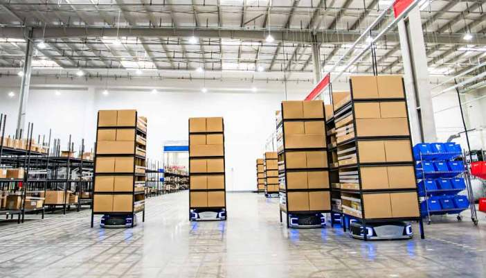 Geek+ robots move shelves in a goods-to-person application in a warehouse