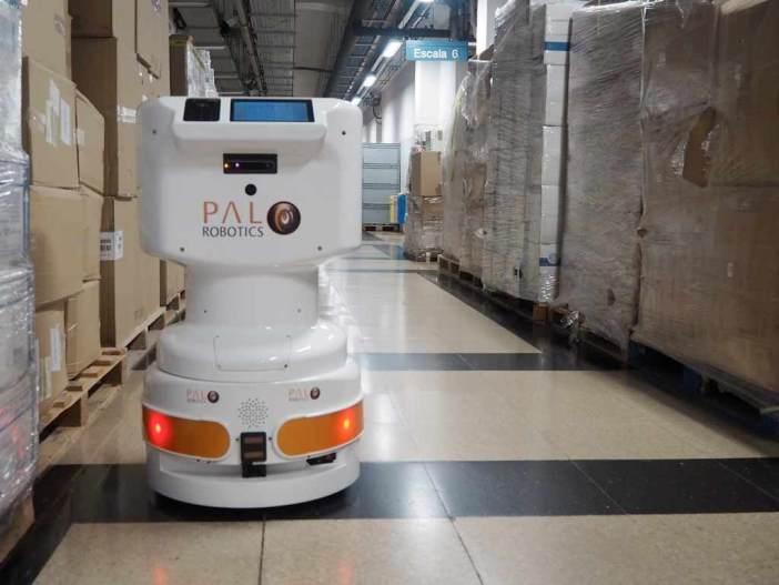 A Tiago mobile robot navigates a hospital aisle