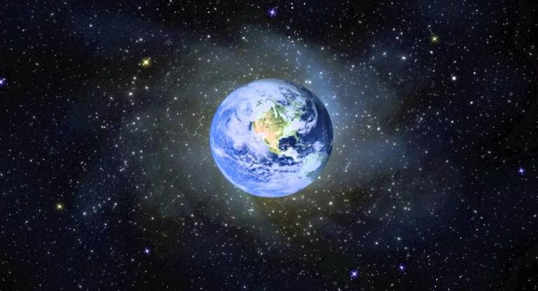 Earth in orbit surrounded with black deep space and white stars background