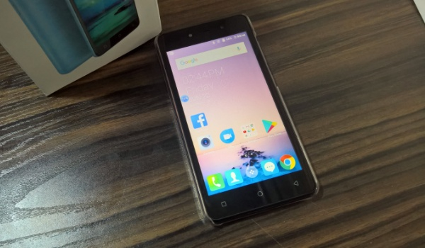 tecno f2 review phone on desk