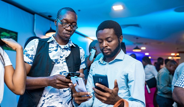 Mister Mobility and wale Oladipupo examining the OPPO Reno2 device at the launch