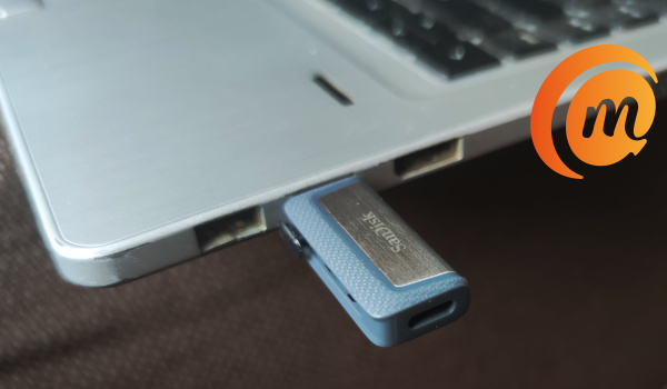 SanDisk Ultra Dual Drive flash drive plugged into laptop