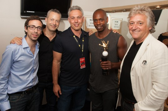Dave Chappelle receiving award for most tickets sold in JFL History