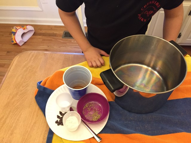 Make kitchen potions with spices, water, pots, pans, and other ingredients