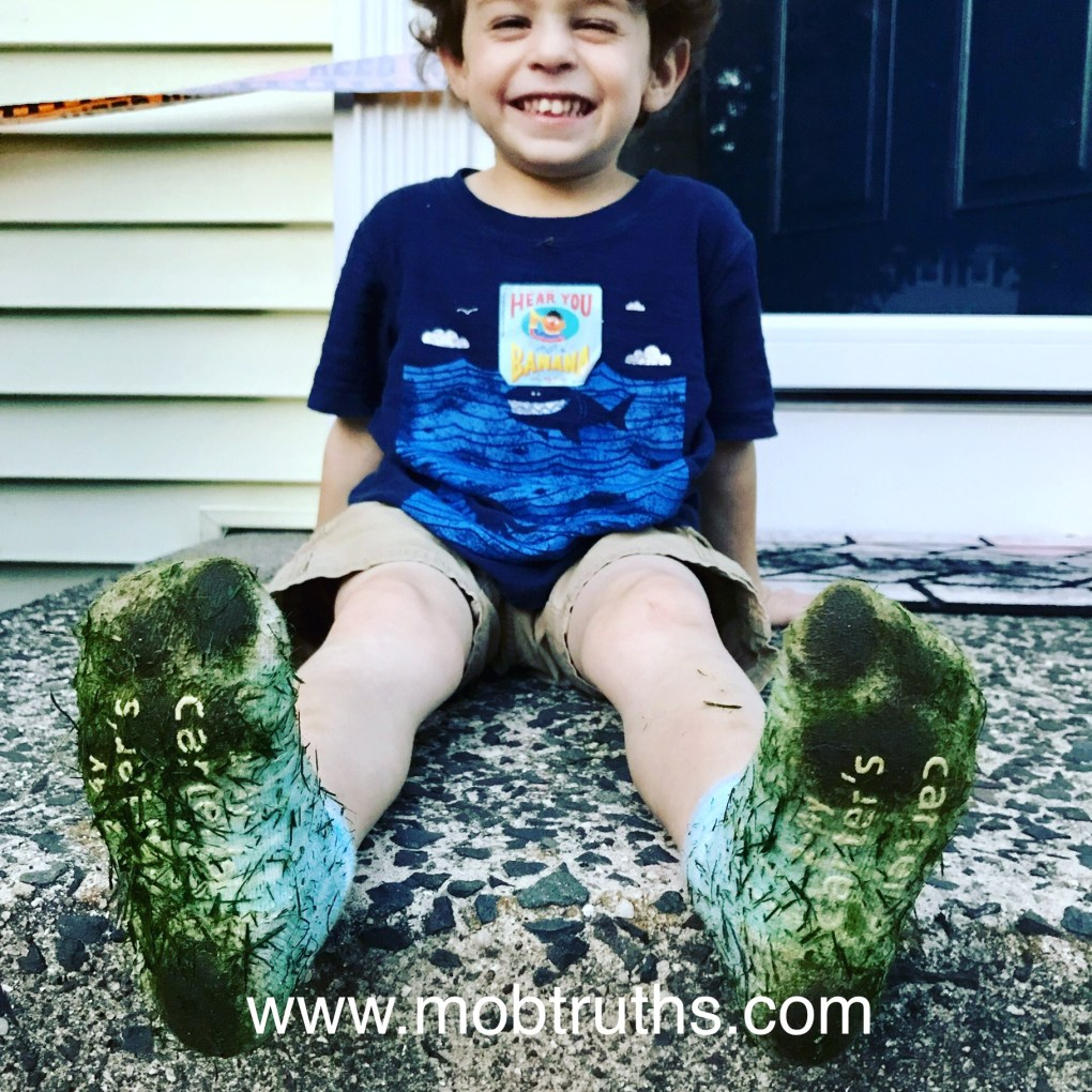 Let them play outside in socks if they want. Look at that smile!