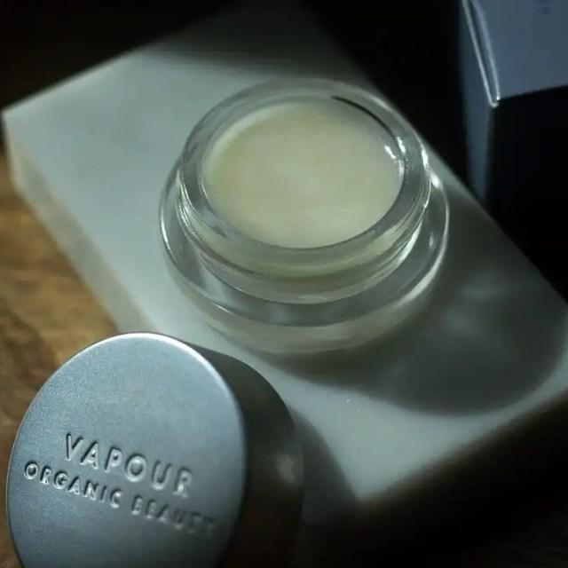An opened jar of Vapour Velvet Lip Gloss