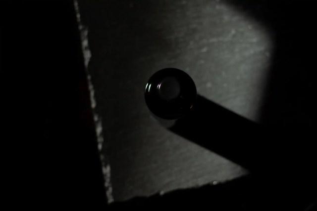 View from top Moon Juice acid potion black bottle on slate board