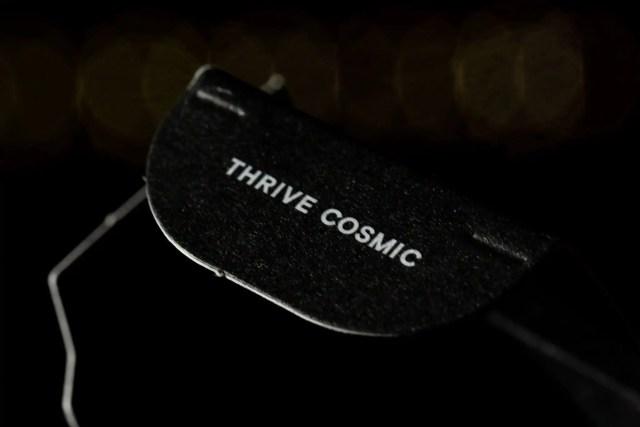 """Moon Juice packaging details macro shot on words """"Thrive Cosmic"""""""
