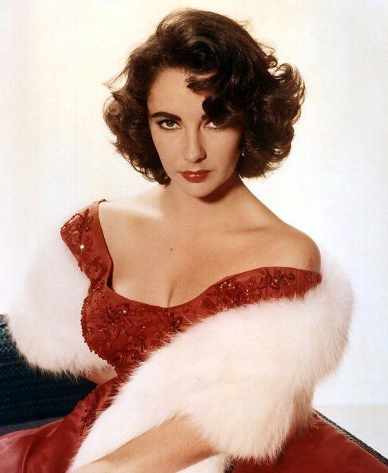 Dizionario della Moda Mame: Valentino. Elizabeth Taylor in rosso Valentino.