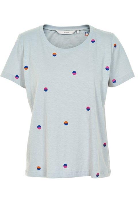 gris claro de algodón con redondeles de colores bordados.