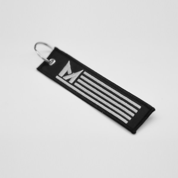 The Modded America Jet Tag Key Chain- the perfect accessory for your keys.