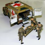 Lens Ambo diorama of a modeller being carted off to Hospital after losing control of his hobby knife