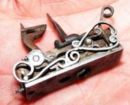 Nick's flintlock mechanism for a miniature gun