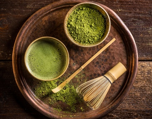 Japanese matcha green powdered tea served in matcha bowl