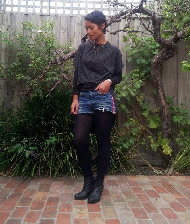 Day 80: I am wearing a long sleeve crew top with a grey hi-lo top over it, denim shorts, cotton bike shorts, stockings and boots