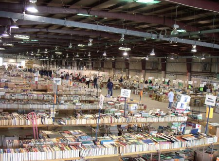 Members of Teamsters Locals 104 and 752 volunteer their time to move more than 8,000 boxes of books. After a week, the books are ready, organized into 27 major categories.
