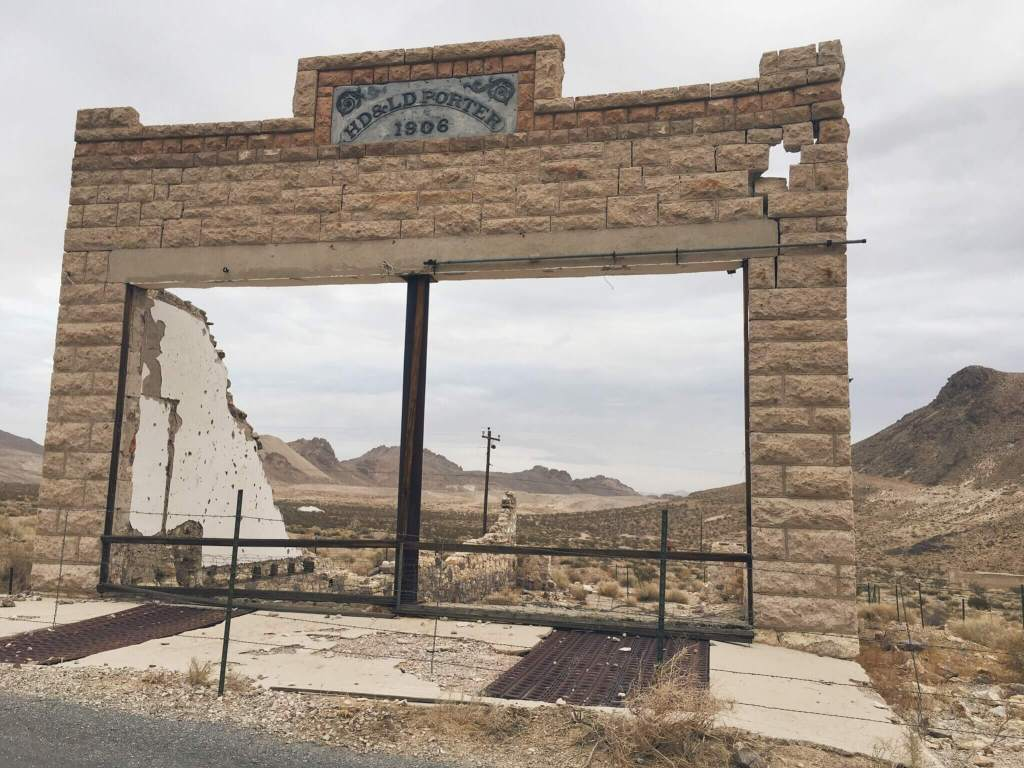 HD&LD Porter 1906 building that is nearly destroyed except for the front facade, Rhyolite Ghost Town, Nevada near Death Valley National Park