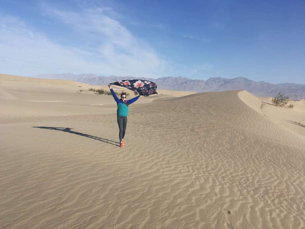 Wind blowing floral scarf, Mesquite Flat Sand Dunes, Death Valley National Park, California